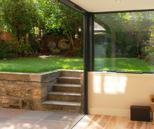 photo of grand green sunfold garden with folding sliding doors sliding doors and grass patio terrace