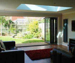 photo of red sunfold garden kitchen area living room with bifold doors folding sliding doors sliding doors lightwell rug rugs