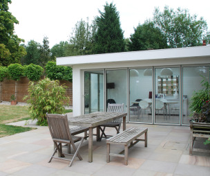 photo of sunfold extension garden studio with folding sliding doors sliding doors bi-fold doors patio doors and garden furniture patio