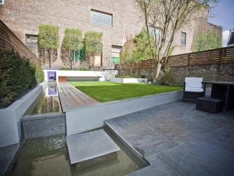 photo of contemporary designer stone lines right angles robert james landscapes garden and decking landscaped patio trees water feature