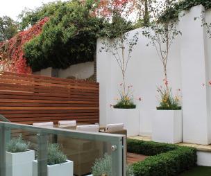 photo of designer modern white robert james landscapes garden and decking giving nature a home landscaped planters urban garden