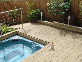 photo of modern robert james landscapes garden with hot tub jacuzzi wine and decking