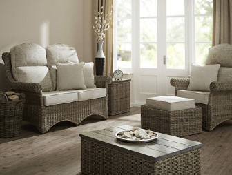 photo of rattan garden furniture centre conservatory living room lounge with doors to garden and coffee table foot stool furniture sofa