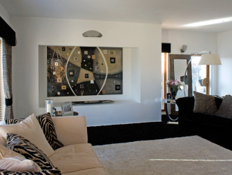 photo of contemporary muted beige house of ugly fish living room lounge with lighting alcove artwork wall art