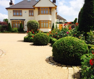 photo of diy kit resin bound gravel logo permaslab sureset driveway garden wiltshire with hard-wearing and environmentally friendly paving permeable paving porous paving resin bound suds surecell tradepack uv stable