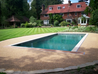 photo of colourful diy kit resin bound gravel logo permaslab sureset garden indoor pool wiltshire with outdoor pool stencil and demarcation environmentally friendly paving permeable paving pool surrounds porous paving resin bound suds surecell tradepack uv stable