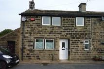 Terraced home in Main Street Stanbury...