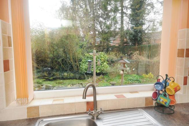 View from the Kitchen Window overlooking pond