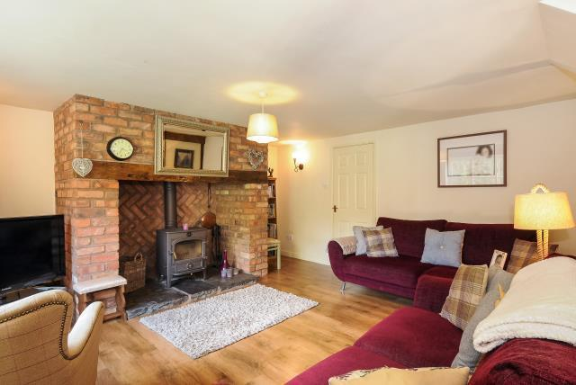 Beautiful Lounge  with feature wood burner