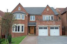 Detached property in Coxley Dell, Horbury...