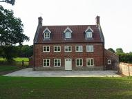 Detached property in Loke Farmhouse, Honing...