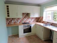 Terraced property in Martley Gardens...