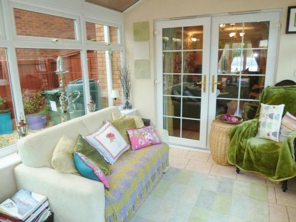 Conservatory leading to living room
