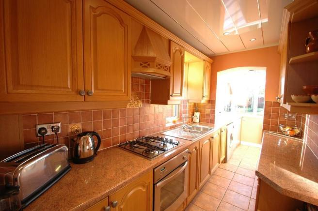 Kitchen leading to utility room