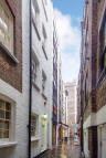 Studio flat in Botolph Alley, London...
