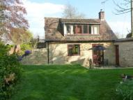 Detached property in Mulberry Cottage...