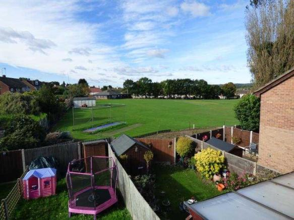 Rear Garden with view over Abrdge Cricket Field