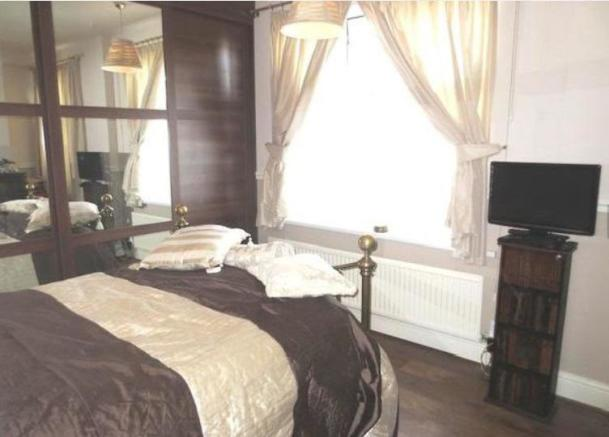 Front first floor bedroom with window in view.jpg