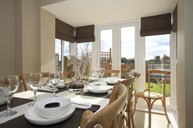 Typical Somerton dining area with glazed bay and French doors