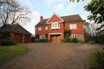 Detached property in Coombe Hill Road...