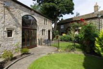Detached home in Loveclough Fold...