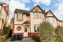 semi detached property in Bramber Road, London...