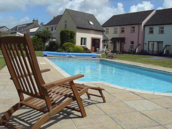 Shared heated pool and gardens (maintained by mana