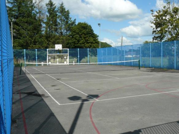 Village tennis courts 2 min walk from property.