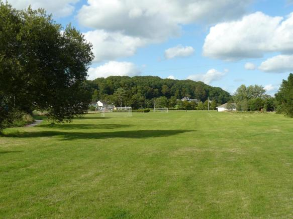 Playing fields 2 min walk from property.