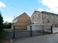 Detached property in Station House Dowlais...
