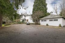 Detached house in Cade Hill Road...