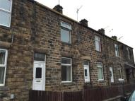 Terraced house in Lees Hall Road...
