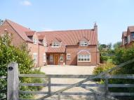 Detached house in Dovecote Meadows...