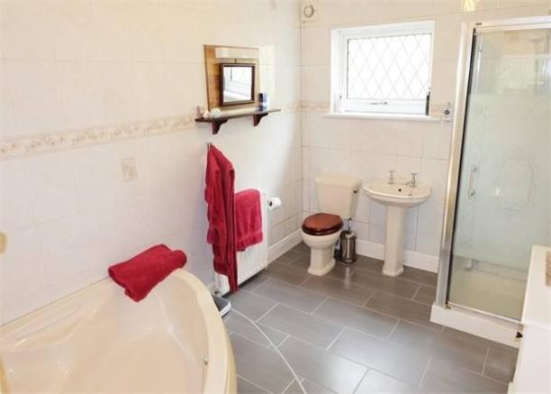 En-suite bath and shower room
