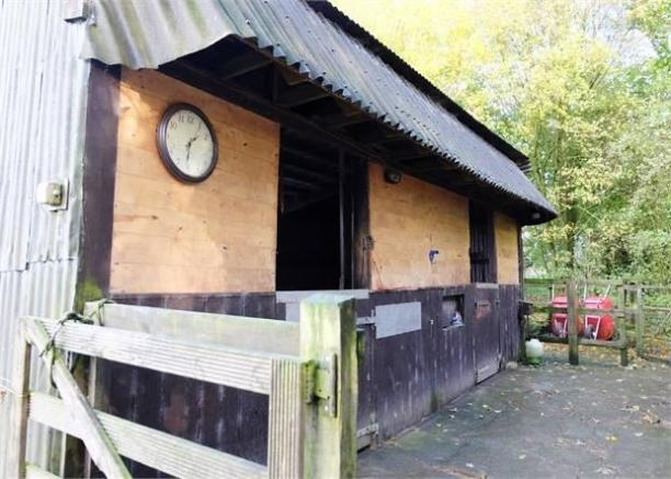 Two wooden stable blocks
