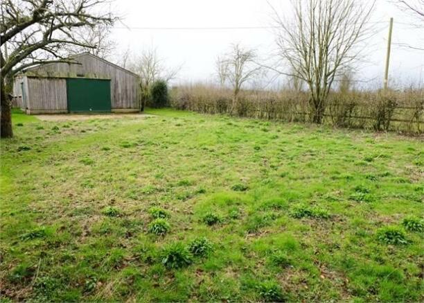 Wildflower grassland and barn