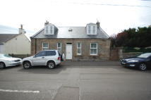 Detached property in 28 Bridge Street...