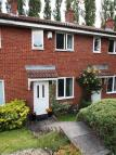 Terraced property in Raddlebarn Farm Drive...