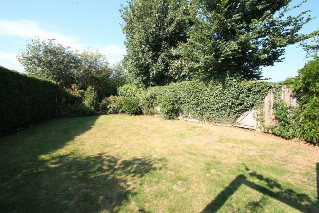 Lawned garden backs playing fields