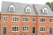 End of Terrace home in Gilcar Villas, Normanton...