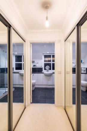 Lovely mirrored doors leading into ensuite