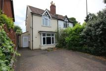 semi detached home in Coombe Lane...