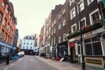 Flat in Rathbone Street, London...