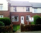 Terraced house in Primrose Gardens, Ouston...