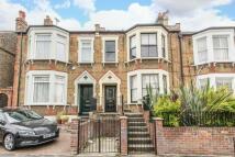Terraced property in Heathwood Gardens London...