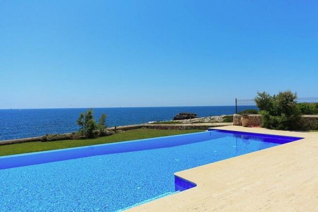 Pool area with sea v