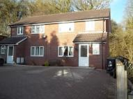 semi detached property in Woodland Close...