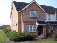Terraced property in Carnation Way...