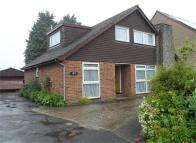 Detached house in High Street, Newington...