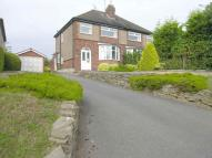 semi detached property in 21 Little Tixall Lane...